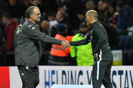 Marcelo Bielsa and Alex Neil shake hands on the touchline at Deepdale