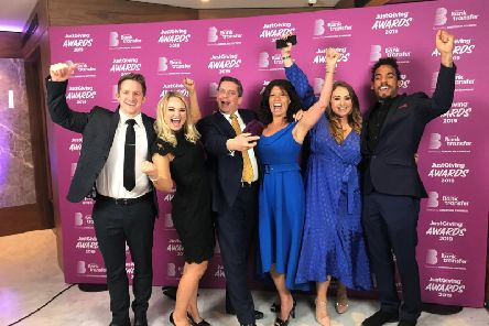 Members of Derian House celebrate the win at JustGiving Awards