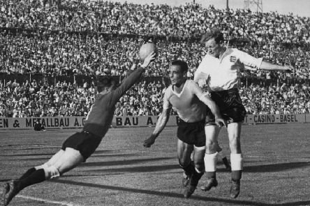 Sir Tom Finney in action for England against Uruguay in the 1954 World Cup in Switzerland - one of 76 appearances for his country