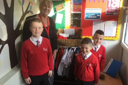 Sharon Heatley and her grandchildren helping out at the Kingsfold pr-loved shop