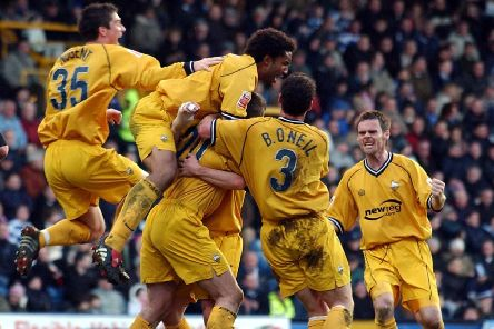 Preston skipper Chris Lucketti is piled on by team-mates after scoring PNE's winner at Queens Park Rangers in February 2005