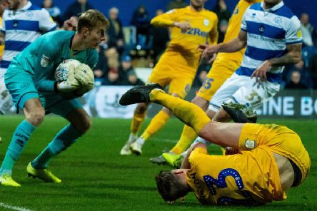 Preston centre-half Paul Huntington lands on the floor after challenging for the ball in the Queens Park Rangers box