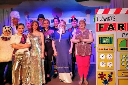 The principal cast of Aladdin with Widow Twankey's FART Machine.