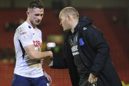 Preston midfielder Alan Browne gets a handshake from Alex Neil at the final whistle at Barnsley
