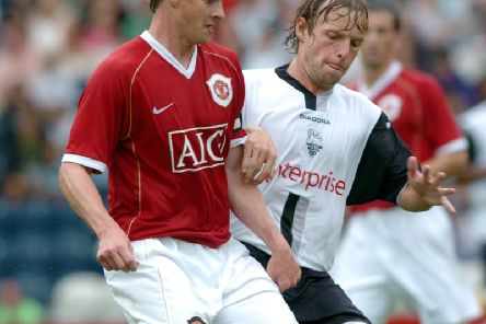 Preston midfielder Paul McKenna shadows Manchester United skipper Ole Gunnar Solskjaer at Deepdale in July 2006