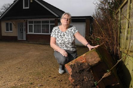 A resident of Whinfield Lane with her damaged wall