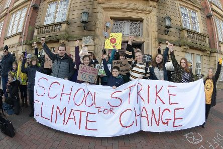 Young protesters campaigning on climate change outside Lancashire County Council's offices in Preston