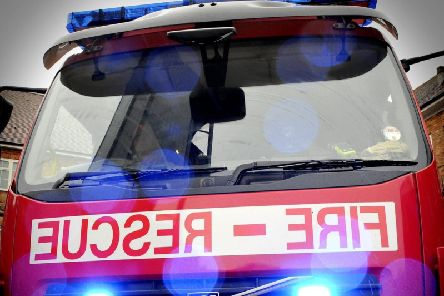 Firefighters used a sledge to rescue two people trapped in water on Longton Marsh.