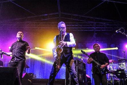 Brian Travers performing with UB40