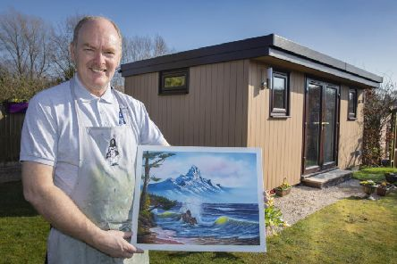 David Wiles with an example of his artwork