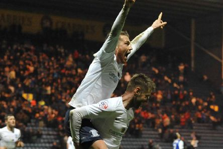 Joe Garner is given a piggy-back by Paul Gallagher after completing his hat-trick in Preston's 3-2 FA Cup replay win over Ipswich in January 2014