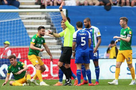 Ryan Ledson (left) is shown the red card by referee Andy Madley as Joe Rafferty looks on