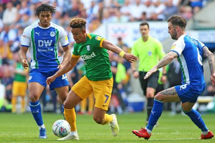 Callum Robinson gets between Wigan's Reece James and Danny Fox