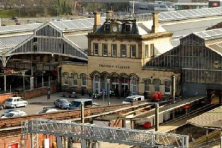 Two men from Blackburn have been charged with assaulting a police officer at Preston Railway Station on Easter Sunday.