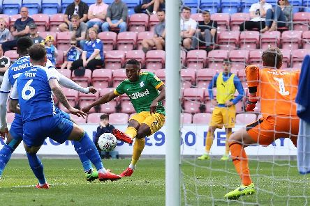 Darnell Fisher sees a shot blocked in Preston's defeat at Wigan