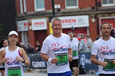 Phil Reece, centre, with Michelle Lee and his son Tom as they ran the Great Manchester 10k for Heartbeat'Photo by Phil's daughter Stephanie