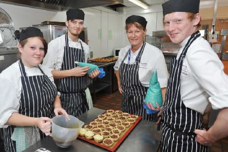 Flashback: former students at work in the kitchen at Foxholes