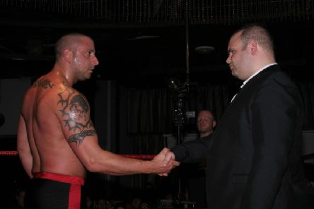2013: 30-man rumble winner Lionheart shakes hands with PCW owner and promoter Steven Fludder at PCW's Springslam event at Lava & Ignite, Preston. Pictures courtesy of Gordon Harris