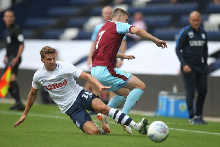 Calum Woods makes a tackle in last year's pre-season friendly against Burnley at Deepdale