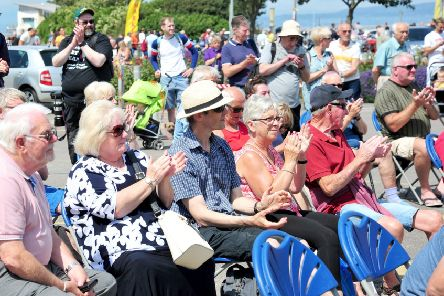 Crowds enjoy Rock It Man performing at Festival Market for Morecambe Music Festival