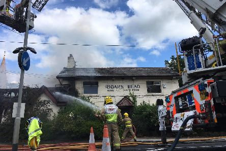 Four fire engines and an aerial ladder platform are tackling the blaze at the pub Pic credit: Gordon Head