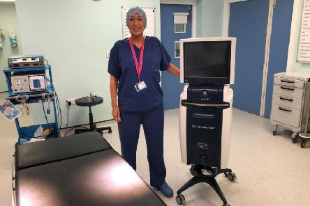 Julie Smith, Plastic Surgery Theatre Nurse/Team Leader, with the new ECT machine at Royal Preston Hospital