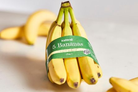 Pre-packaged bananas which are being sold in a recycled paper band