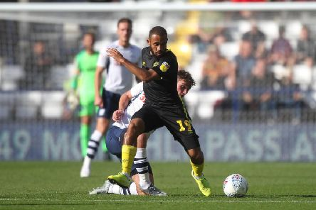 Preston midfielder Ryan Ledson puts in a challenge on Brentford's Bryan Mbeumo