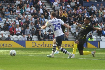 Tom Barkhuizen scores Preston's second goal against Brentford at Deepdale