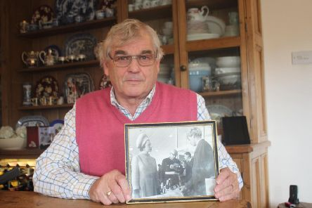 Mick Coxhead with the photo  of himself at 17 meeting The Queen