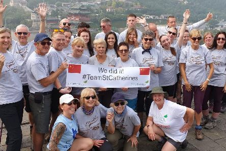 Some of Team St Catherine's celebrating after completing their Great Wall of China challenge.