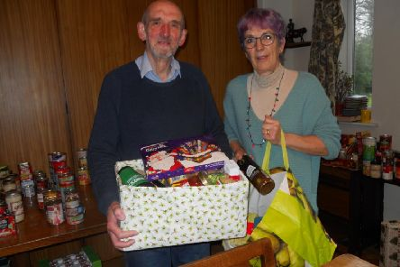 Farington Parish Coun Mike Otter, pictured with Barbara Bidwell, has been overwhelmed with Christmas donations to St Marys Church food bank