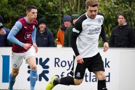 Bamber Bridge's Alistair Waddecar in action against South Shields earlier this season