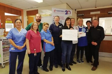 Ashleigh Jackson presents a cheque to Rosemere