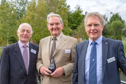 David Hindle receives his award from (l) Peter Titley, Marsh Christian Trust and (r) Martin Spray, CEO, WWT