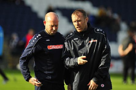 John Hills (left) with assistant Brett Ormerod at Saturday's FA Cup tie
