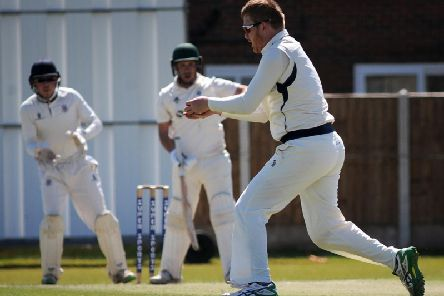 St Annes' Tom Higson dismisses Fulwood and Broughton's former England player Simon Kerrigan caught and bowled   Picture: ROB LOCK
