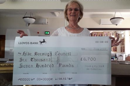 Margaret Race, chairman of the Friends of the Lytham St Annes Arts Collection, with the cheque for 6,700 donated to Fylde Council for preservation of items in the Collection