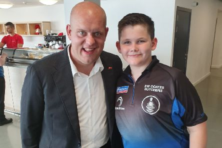 Henry Coates meets darts superstar Michael Van Gerwen during his visit to Gibraltar.