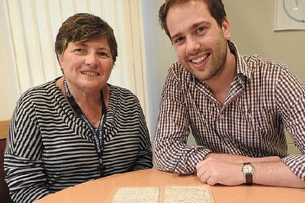Charity chief Bev Peck and TV antiques expert Tim Medhurst with the letter, hand-written by Florence Nightingale. (PHOTO BY: Weldmar/BNPS)
