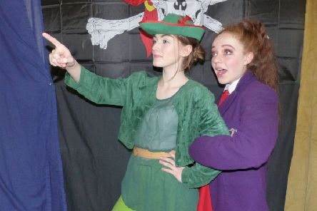 Minnie Hibbert as Peter Pan and Ellie Craufurd-Stuart as Wendy in Captain Hook's Revenge, presented by Buxton Drama League.
