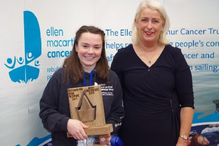 Rosa Coker-Burnett, from Edale, being presented the award by Luke's mum Julie Gilbert.