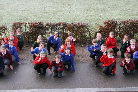Local school kids make the shape of 100 to celebrate the 100th anniversary of Hall Leys Park in Matlock.
