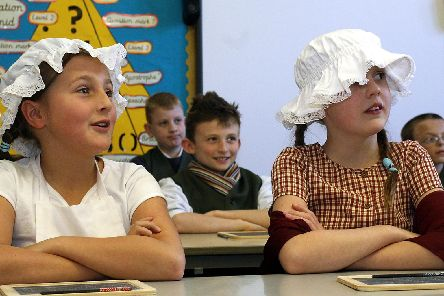 2007 - Crich Junior School pupils learn to keep their backs straight and their arms folded at all times as they experience life in a Victorian classroom.