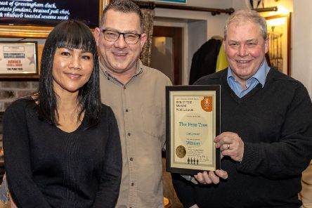 Pub of Season: Andy Kassube presents the award to Emmy and Alan Ingle.