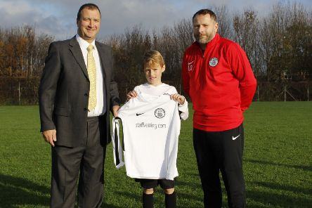 Leeroy Odd, right, North Shields Under 11s Football Club, with player Elliott Odd and Stephen Brown, managing director, Staffvetting.com.