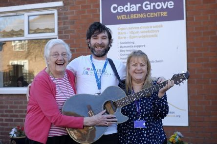 Cedar Grove regular Audrey Pym, 93, with musician Alan Jones and EveryDay centres' manager Michelle Clements. Picture by RusbyMedia.