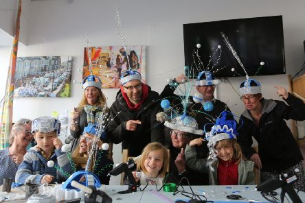 Families at the first hat making session for the Whitley Bay Carnival at the Big Local Shop.
