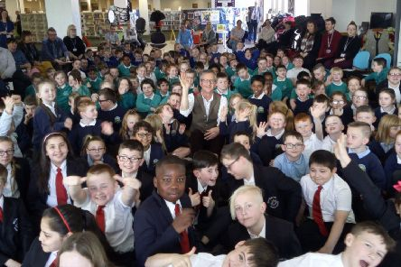 Illustrator Martin Brown with pupils at the event in Wallsend.