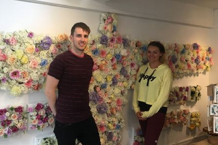 Hannah and Tom with the latest exhibition at For the Love of the North.